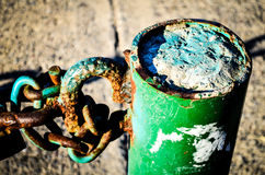 Break the chains. Breaking the rusty and green chains Royalty Free Stock Images
