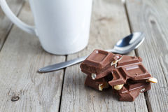 Break with chocolate. Cup and chocolate on wood Royalty Free Stock Image