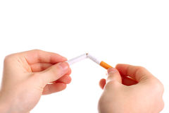 Break a cigarette. Person breaking a cigarette isolated on the white Stock Photos