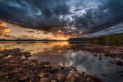 A break in the clouds. A spectacular June sunset above Follsjå at Bolkesjø, Telemark, Norway Royalty Free Stock Images
