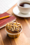 Break for coffee and muffin at the office. Royalty Free Stock Photo