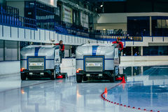 Break during competition. work two ice resurfacing machines for ice rink Stock Photo