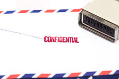 Break through the Confidential Letter. On white table Royalty Free Stock Images