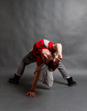 Break dance. Performer on grey studio background royalty free stock images