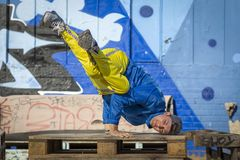 Break dance movement, performer on the street, Playground. stock image