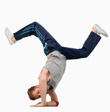 Break dancer doing a hand stand. Against a white background Stock Photos