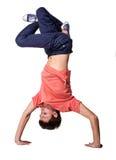 Break dancer doing handstand against  white Stock Photography