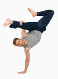 Break dancer doing an one handed handstand Stock Photos