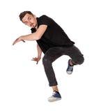 Break dancer doing one handed handstand against a Stock Images