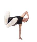 Break dancer doing one handed handstand against a Stock Photos