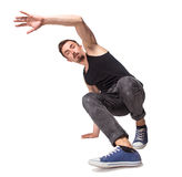 Break dancer doing one handed handstand against a Stock Image