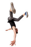 Break dancer doing one handed handstand against a Royalty Free Stock Photos