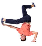 Break dancer doing one handed handstand against a Royalty Free Stock Photo