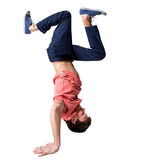 Break dancer doing one handed handstand against a Stock Photos