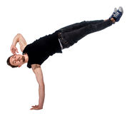 Break dancer doing one handed handstand against a Stock Photography