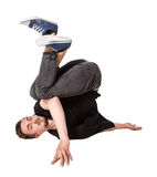 Break dancer doing one handed handstand against a Royalty Free Stock Image