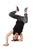 Break dancer doing one handed handstand against a Royalty Free Stock Photography