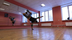 Break dancer in training. Guys are trained in the dance hall stock footage