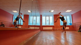 Break dancer in training. Guys are trained in the dance hall stock video footage