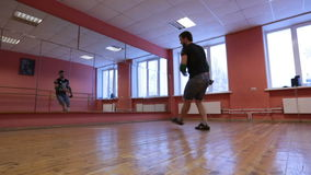 Break dancer in training. Guys are trained in the dance hall stock video
