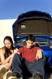 Break down. Couple sitting down after car break down Royalty Free Stock Images