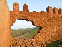 Break down the wall, The freedom is outside. Broken wall and road to freedom. (morocco Royalty Free Stock Images