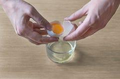 Break an egg stock images