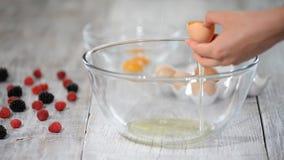 Break egg. Cooking food. Baking ingredients, breaking the eggs, separating yolk from protein. stock video