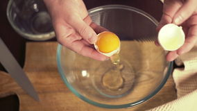 Break egg. Cooking food. Baking ingredients. Separating yolk from the protein stock video