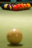 Break (Focus Far). A set of billiard balls ready to be broken. Focus is on the numbered balls Stock Photo