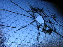 Break Free. Broken window with blue sky showing through from behind Stock Image