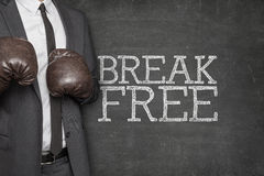 Break free on blackboard with businessman on side stock photos