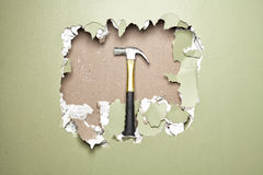 Break green wall  hammer Royalty Free Stock Photos