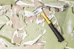 Break green wall  hammer smash Royalty Free Stock Images