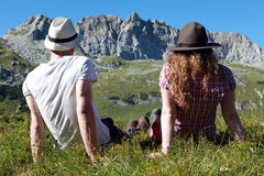 Break during a hiking tour. Young people make a short break during a hiking tour in the Austrian Alps Royalty Free Stock Photo