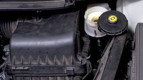 Break master cylinder fluid check Royalty Free Stock Images
