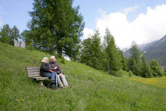 Break in the mountains. A couple is relaxing in the alps Stock Images