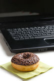 Break in the  office . doughnut on laptop keyboard Royalty Free Stock Images