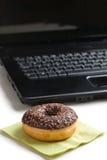 Break in the  office . doughnut on laptop keyboard Royalty Free Stock Images