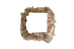 Break out. A wall with a big hole, bricks can be seen, Looks like a prisoner has escaped from prison royalty free stock image