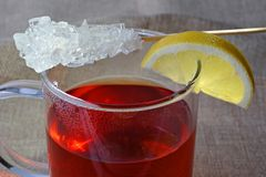 Break with rooibos tea. Rooibos tea with rock candy and a slice of lemon Stock Photo