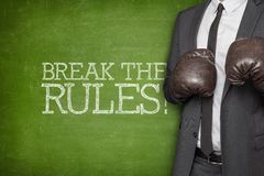 Break the rules on blackboard with businessman Stock Photos
