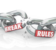 Break Rules Rebel Protest Breaking Chains. Break Rules words on breaking chains to illustrate protesting or objecting to unfair laws or regulations Stock Photography