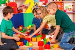 Break school of children playing in kids cubes indoor. royalty free stock photos