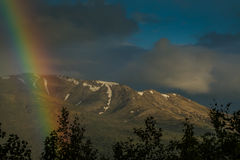 A break in the storm. A rainbow is seen after a spring storm in a alaska Stock Photos