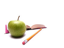 Break from studying. Image shows an apple for a snack to take a break from studying. Apple is the main focus with the addition of a pencil and a book in the royalty free stock images