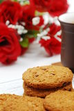 Break time. Cookies, chinese tea and red rose Stock Photography