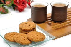 Break time. Cookies, chinese tea and red rose Royalty Free Stock Images