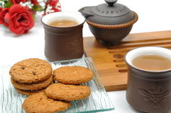 Break time. Cookies, chinese tea and red rose Stock Photos