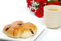 Break time. Bread, japaness green tea and red rose Royalty Free Stock Photography